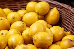 Ripe lemons. Lemons in the basket, shallow DOF Stock Photography
