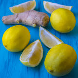 Ripe lemons and root of ginger Royalty Free Stock Photo