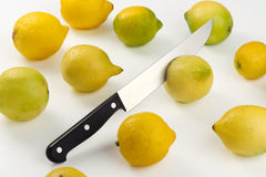 Ripe lemons and sharp knife Stock Image
