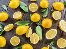Ripe lemons on the wooden table. Royalty Free Stock Images