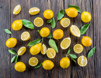 Ripe lemons on the wooden table. Top view Stock Photos