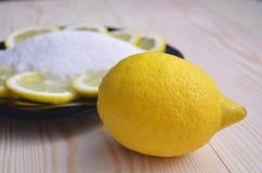 Ripe lemons on wooden vintage background. Healthy vegetarian food. royalty free stock image
