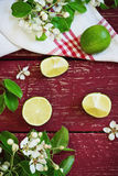 Ripe lime. And branches with flowers on the old wooden background. top view. healthy fruit from his garden Royalty Free Stock Photos