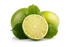 Ripe lime fruits with green leaves isolated Stock Photos