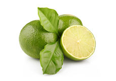 Ripe lime fruits with green leaves isolated Stock Photo