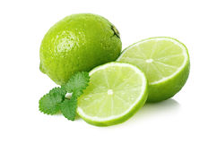 Ripe lime with a half and melissa royalty free stock photo