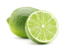 Ripe lime isolated. Sliced ripe green lime fruit isolated on white background stock photos