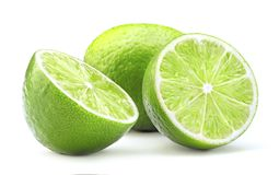 Ripe lime isolated. Sliced ripe green lime fruit isolated on white background stock photography