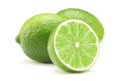Ripe lime isolated. Sliced ripe green lime fruit isolated on white background royalty free stock photos