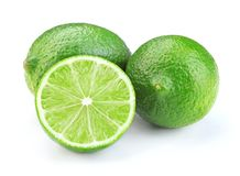 Ripe lime isolated. Sliced ripe green lime fruit isolated on white background royalty free stock images