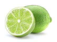 Ripe lime isolated. Sliced ripe green lime fruit isolated on white background royalty free stock photography