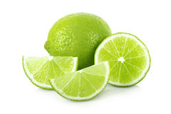 Ripe lime with slices. On white background Stock Images