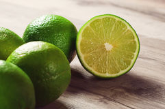 Ripe lime. On a wooden table Stock Photo
