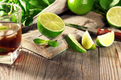Ripe lime. On a wooden table with mint. Ingredients for cocktail Stock Images