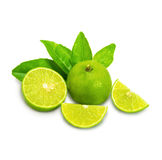 Ripe limes with green leaf. Isolated on white background. As package design element Stock Photos