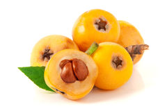 Ripe loquat or Eriobotrya japonica with leaf isolated on white b royalty free stock image