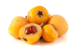 Ripe loquat or Eriobotrya japonica with leaf isolated on white background stock photos