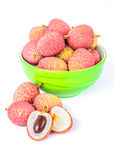 Ripe lychee fruit in green bowl against white background Stock Photography