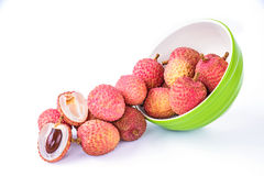 Ripe lychee fruit in green bowl against white background Stock Images