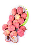 Ripe lychee fruit in green bowl against white background Royalty Free Stock Image
