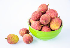 Ripe lychee fruit in green bowl against white background Royalty Free Stock Photography