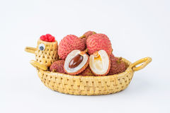 Ripe lychee fruit in hen basket against white background Stock Photo