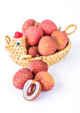 Ripe lychee fruit in hen basket against white background Royalty Free Stock Photo