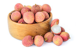 Ripe lychee fruit in wooden bowl against white background Royalty Free Stock Image