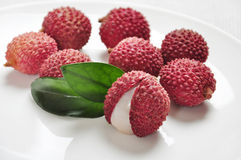 Ripe lychees. Fresh ripe lychees bunch on a plate close up, sallow dof Stock Image