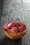 Ripe lychees in wood bowl Royalty Free Stock Image