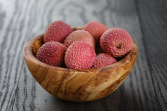Ripe lychees in wood bowl Royalty Free Stock Images