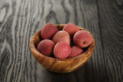 Ripe lychees in wood bowl Royalty Free Stock Photo