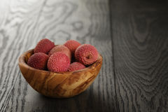 Ripe lychees in wood bowl Royalty Free Stock Photography
