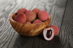 Ripe lychees in wood bowl Stock Photography