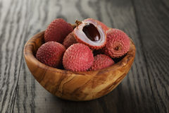 Ripe lychees in wood bowl Royalty Free Stock Photos