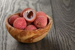 Ripe lychees in wood bowl on table Royalty Free Stock Photography