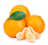 Ripe mandarin with leaf close-up on a white background. Tangerine orange with leaf on a white background. Stock Image