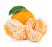 Ripe mandarin with leaf close-up on a white background. Tangerine orange with leaf on a white background. Royalty Free Stock Photo