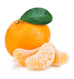 Ripe mandarin with leaf close-up on a white background. Tangerine orange with leaf on a white background. Royalty Free Stock Photography