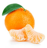 Ripe mandarin with leaf close-up on a white background. Tangerine orange with leaf on a white background. Royalty Free Stock Images