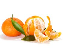 Ripe mandarin with leaves close-up Stock Image