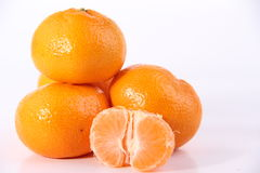 Ripe mandarines with leaves close-up on a white background. Fruit Mandarines Concept and Decoration royalty free stock image