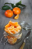 Ripe mandarins in a glass jar Royalty Free Stock Photography