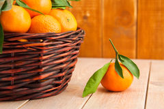 Ripe mandarins with leaves in a basket Royalty Free Stock Photography