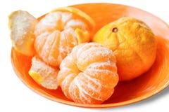 Ripe mandarins in orange plate Stock Photography