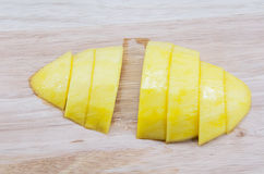 Ripe mango cut into pieces on Wooden royalty free stock photo