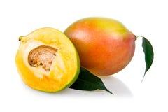 Ripe mango fruits with leaves isolated Stock Photos