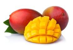 Ripe mango fruits with slices isolated on white Stock Image