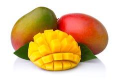 Ripe mango fruits with slices isolated on white Stock Images