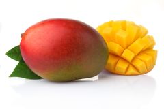 Ripe mango fruits with slices isolated on white Royalty Free Stock Images